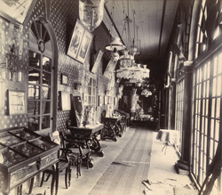 [Interior of a house in the Sakar Bag, Junagadh, showing a long corridor adorned with pictures and furnishings.]